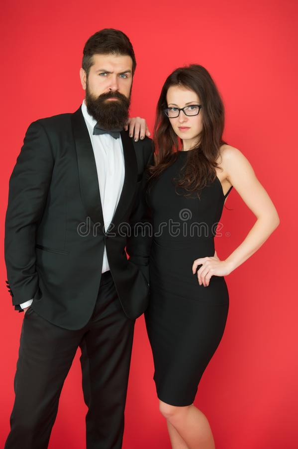 He will melt your heart. Bearded man and woman dating. couple in love on date. Formal couple of man in tuxedo and stock photo