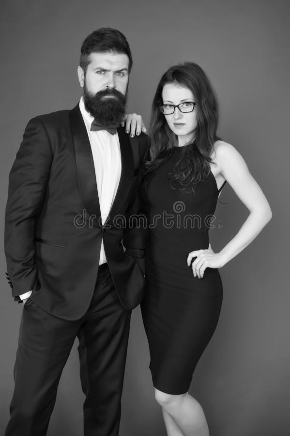 He will melt your heart. Bearded man and woman dating. couple in love on date. Formal couple of man in tuxedo and sexy stock photos