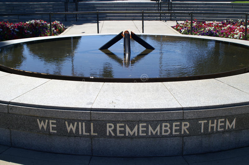 We Will Remember Them. The Flame of Remembrance within the Pool of Reflection was inaugurated by Queen Elizabeth II on 1 April 2000 and burns continuously. It stock photography