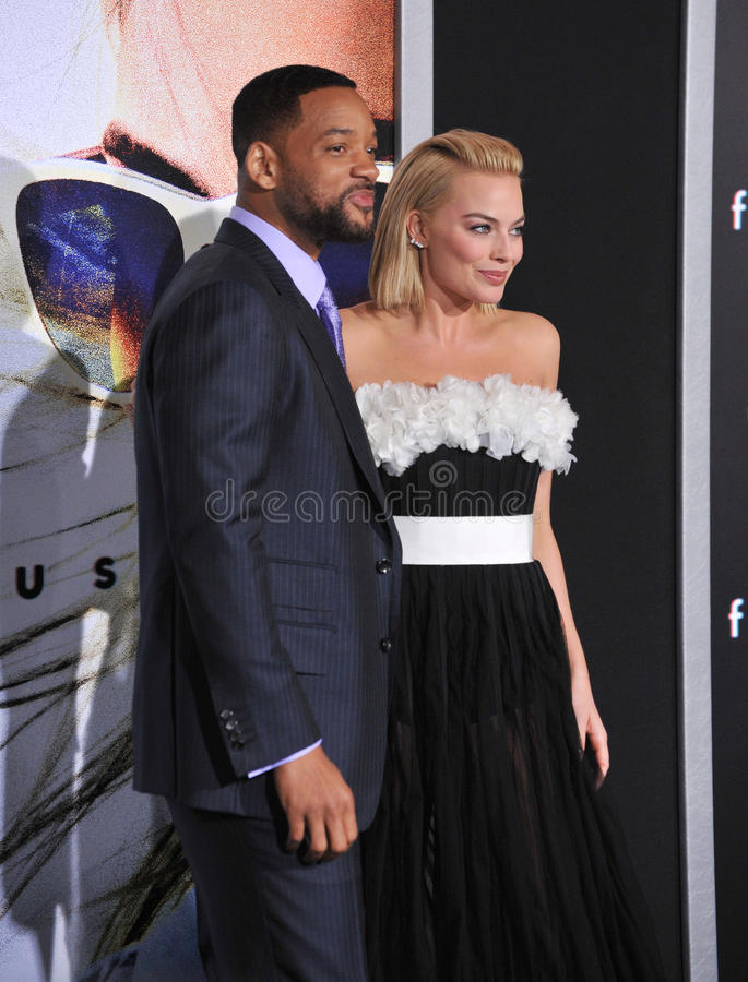 Will Smith & Margot Robbie. LOS ANGELES, CA - FEBRUARY 24, 2015: Will Smith & Margot Robbie at the Los Angeles premiere of their movie Focus at the TCL Chinese royalty free stock photography