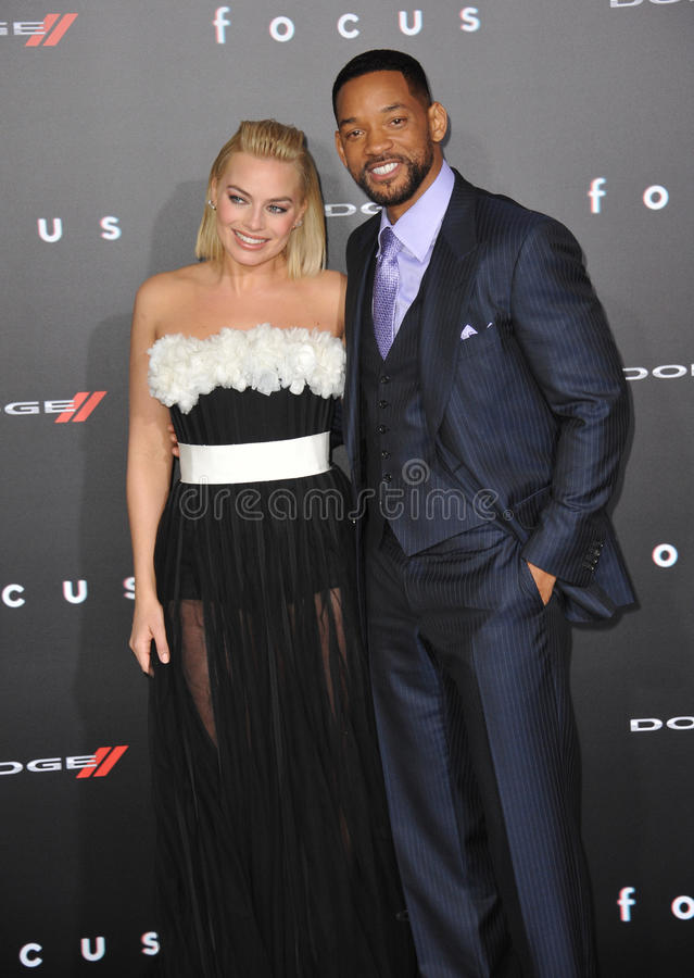 Will Smith & Margot Robbie. LOS ANGELES, CA - FEBRUARY 24, 2015: Will Smith & Margot Robbie at the Los Angeles premiere of their movie Focus at the TCL Chinese royalty free stock photo