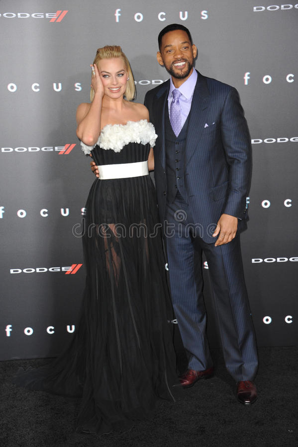 Will Smith & Margot Robbie. LOS ANGELES, CA - FEBRUARY 24, 2015: Will Smith & Margot Robbie at the Los Angeles premiere of their movie Focus at the TCL Chinese royalty free stock image