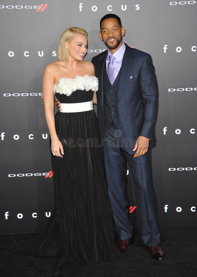 Will Smith & Margot Robbie. LOS ANGELES, CA - FEBRUARY 24, 2015: Will Smith & Margot Robbie at the Los Angeles premiere of their movie Focus at the TCL Chinese royalty free stock images