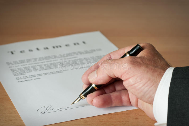 Will write. Mann wrote his will in color stock image