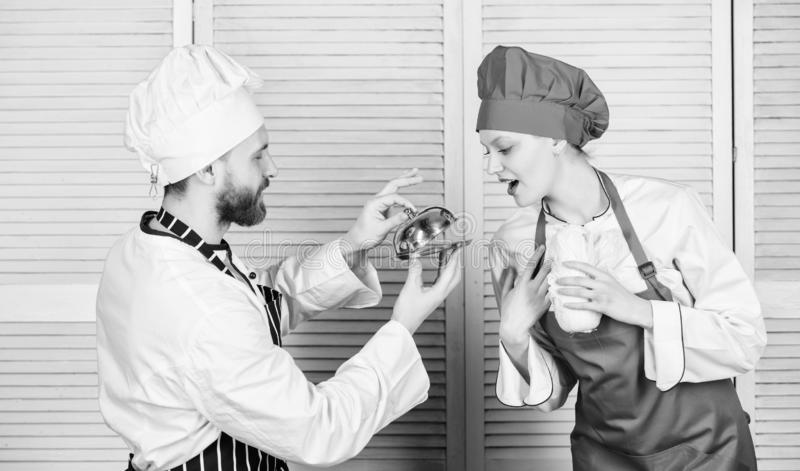 Will you eat my meal. Culinary family. Woman and bearded man cooking together. Cooking exclusive meal. Join gourmet stock image