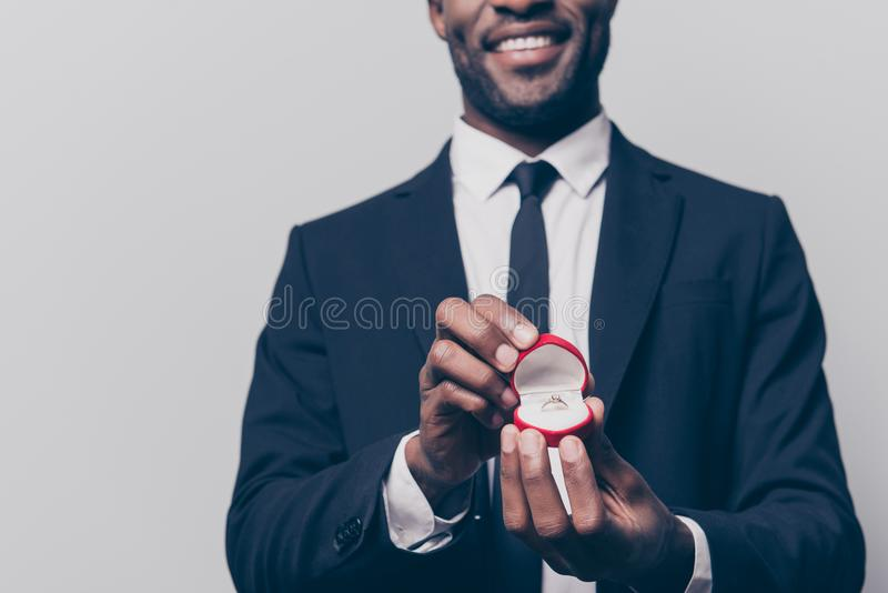 Will you marry me? Cropped close up photo of happy cheerful excited man dressed in smart suit holding a red box with engaging tin stock photos