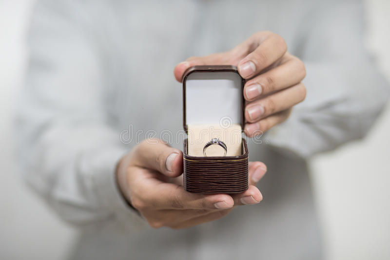 Will you marry me. Men put boxes in the ring to get married royalty free stock images