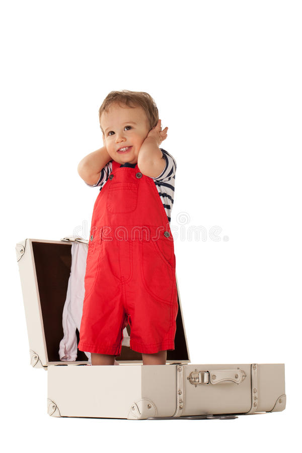 Will you take me with you?. Little boy in suitcase wanting to go for vacations with you royalty free stock image