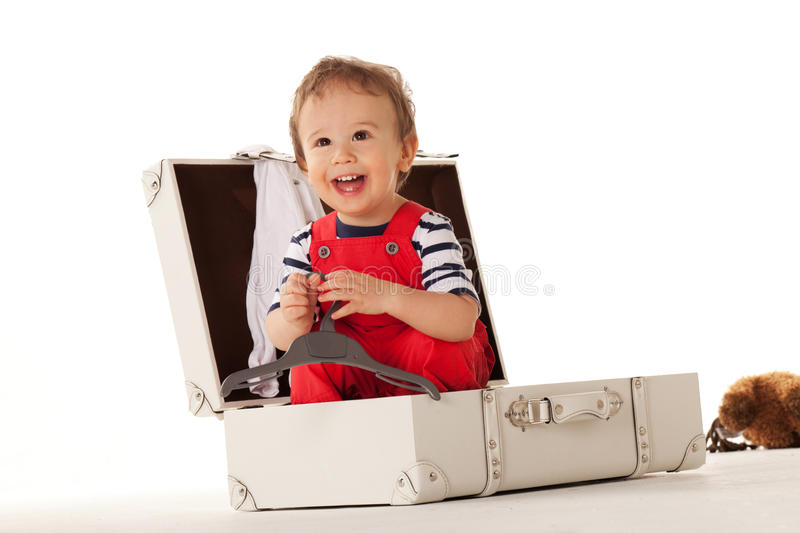 Will you take me with you?. Little boy in suitcase wanting to go for vacations with you stock photography