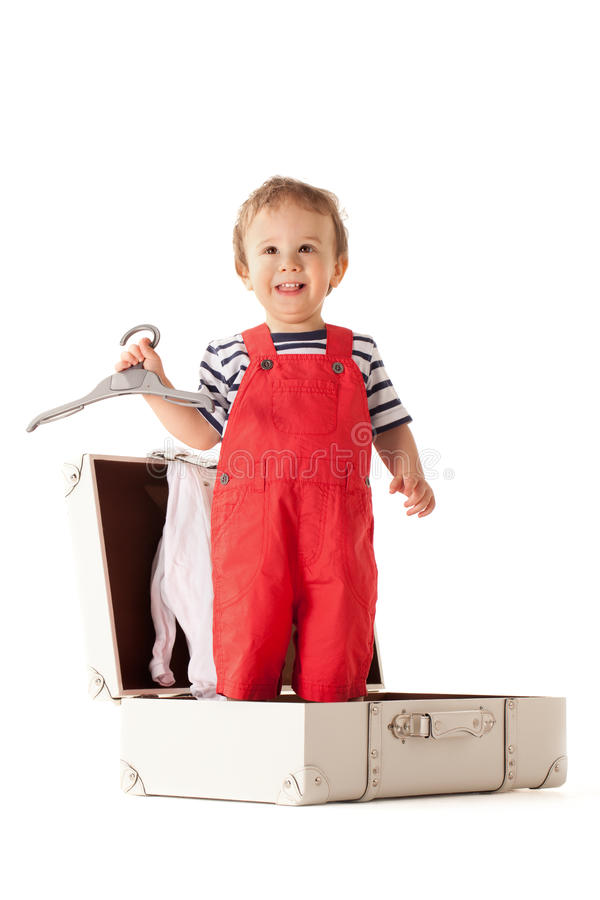 Will you take me with you?. Little boy packing stuff for vacations royalty free stock photo