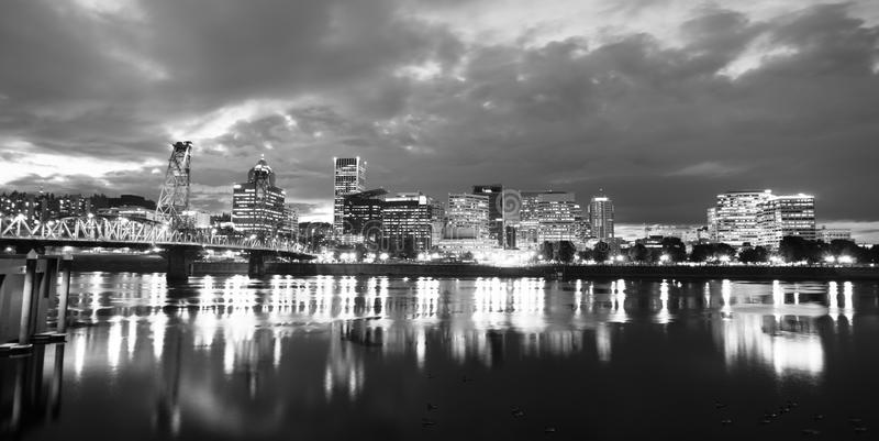 Willamette River Waterfront Portland Oregon Downtown City Skyline. Black and White representation of downtown Portland Oregon at night stock images