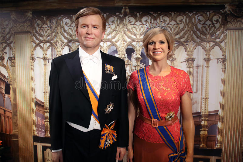 Willem-Alexander, king of the Netherlands and his wife Queen Maxima wax statues royalty free stock images