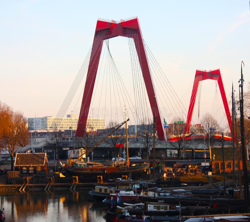 Willemsbrug, the red bridge in Rotterdam seen at sunset time over the harbor royalty free stock photos