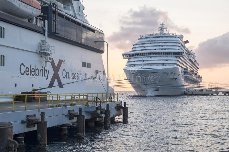 Willemstad, Curacao - April 11, 2018: Carnival Vista and Celebrity Equinox Cruise Ships docked in Willemstad Curacao at Sunset royalty free stock image