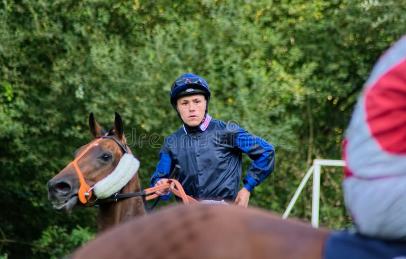 William Carver Horse racing jockey. Flat racing jockey William Carver pictured riding Invisible One before a race at Lingfield Park on 10th August 2019. The pair stock photography