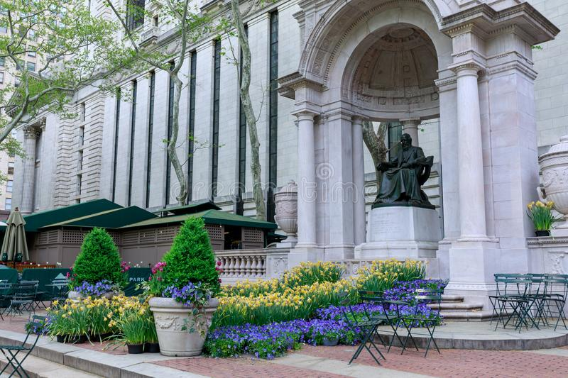 The William Cullen Bryant Memorial in Bryant Park in NYC. New York, USA - May 7, 2018 : The William Cullen Bryant Memorial in Bryant Park in NYC stock photos