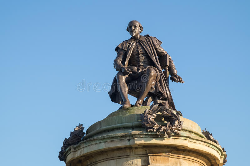 William Shakespeare monument in Stratford-upon-Avon. The sculpture of William Shakespeare, known as the Gower Monument, in his home town of Stratford-upon-Avon royalty free stock photo