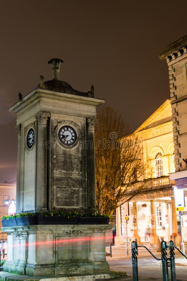 William Thomas Sims 19th Century clock tower by night. ENGLAND, STROUD - 02 NOV 2015: William Thomas Sims 19th Century clock tower by night royalty free stock photos