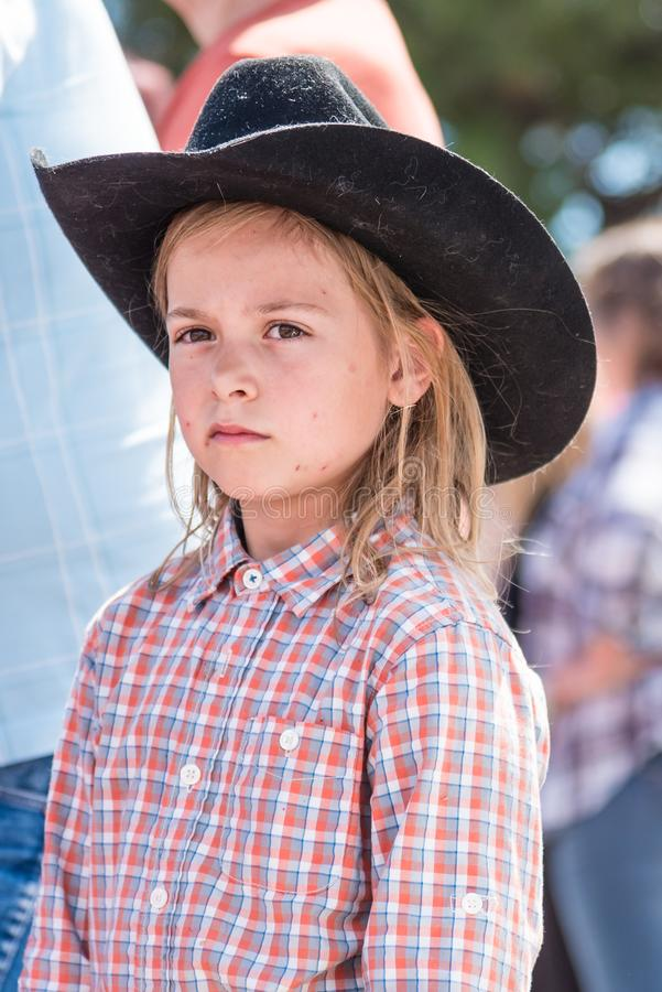 Young girl wearing cowboy hat watches the Williams Lake Stampede Parade stock photo