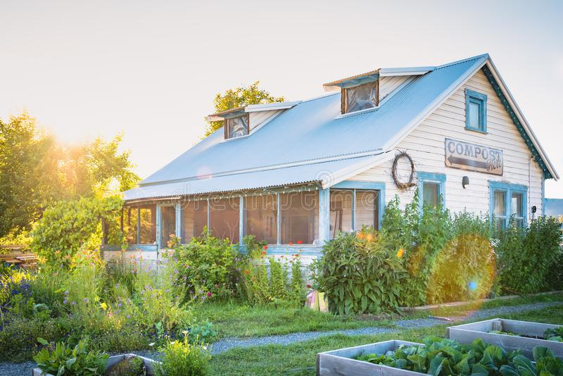 Heritage home surrounded by blooming gardens at sunset royalty free stock photo