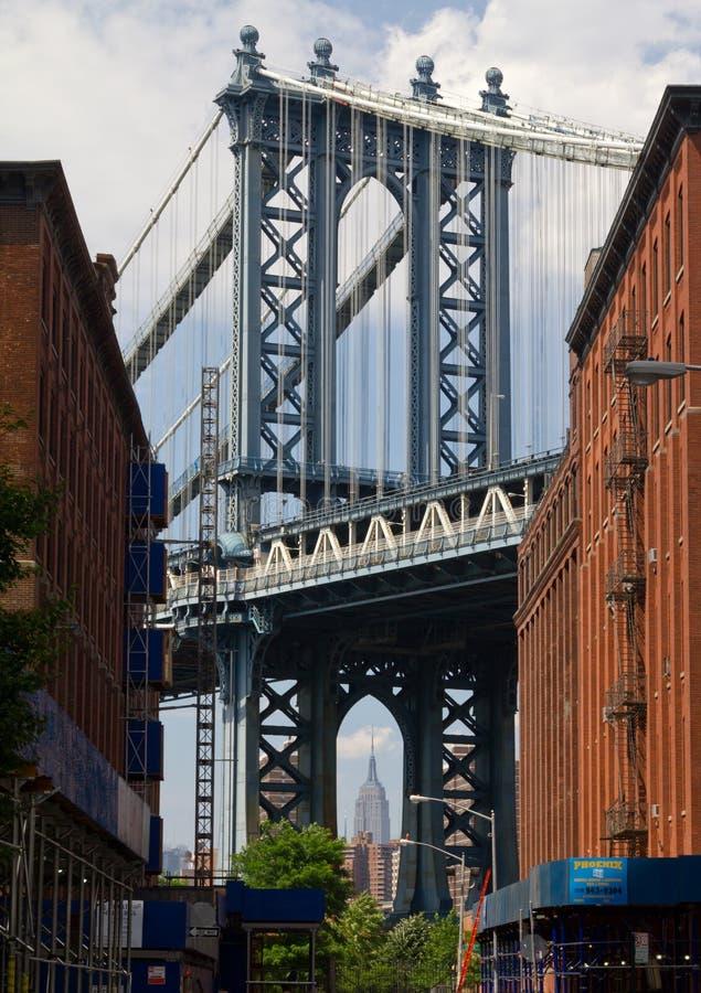 Williamsburg-Brücke und das Empire State Building lizenzfreie stockfotos