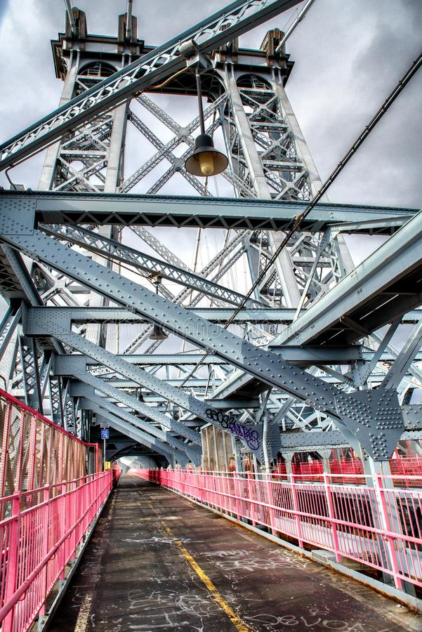 The Williamsburg Bridge is a suspension bridge across the East River in New York City , USA royalty free stock photography