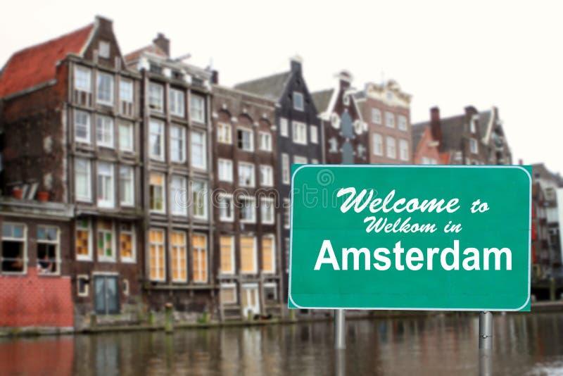 Willkommen nach Amsterdam kennzeichnen innen Wasser lizenzfreie stockbilder