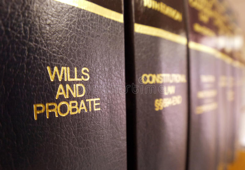Wills and Probate. Law books on shelf with the volume on Wills and Probate in focus. A concept in estate planning royalty free stock photos