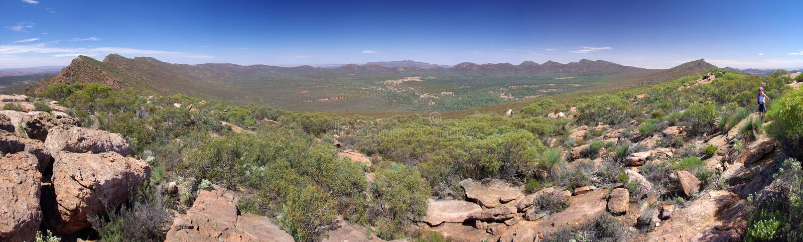 Wilpena Pound Panorama. A young woman admiring the panoramic view over the Wilpena Pound formation. Flinders Ranges National Park, South Australia royalty free stock images