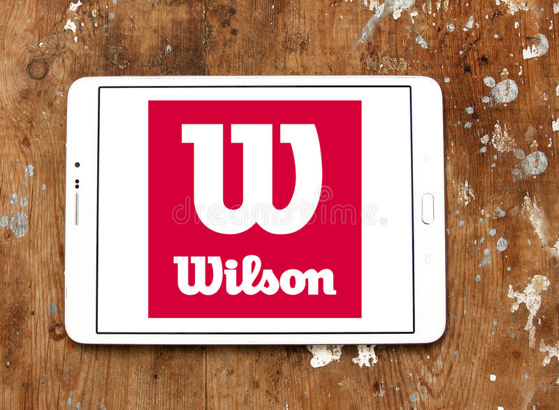 Wilson sporting goods logo. Logo of sports goods company, Wilson on samsung tablet on wooden background stock photos