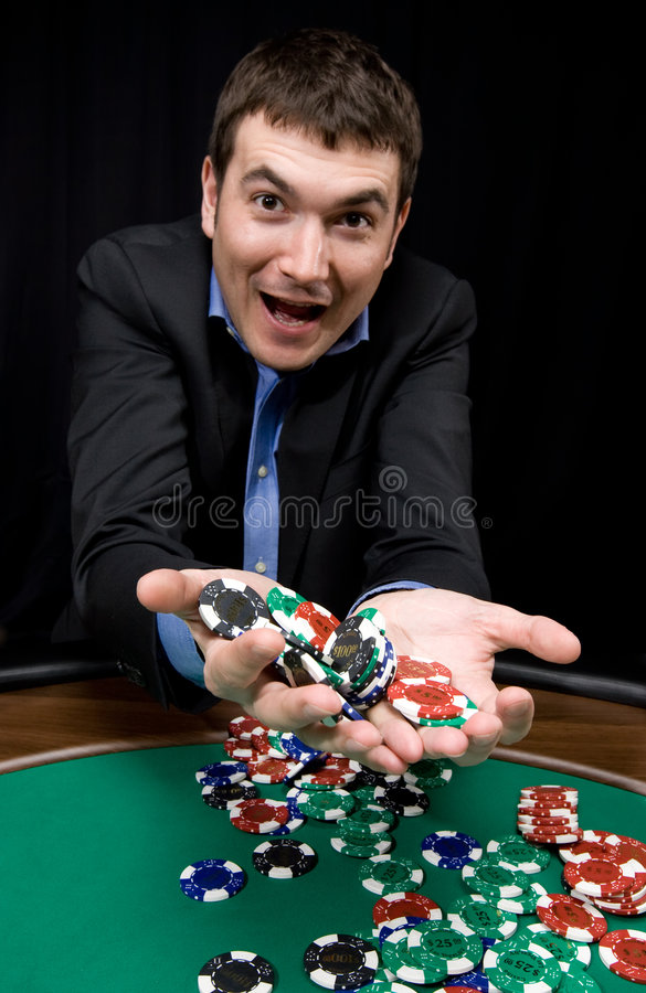 Win in the casino. Fantastic win of stylish man in the casino over black stock images