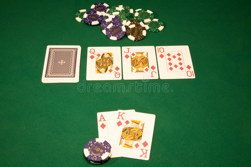 Win in the casino poker. Royal flash in the poker on the green tabl royalty free stock images