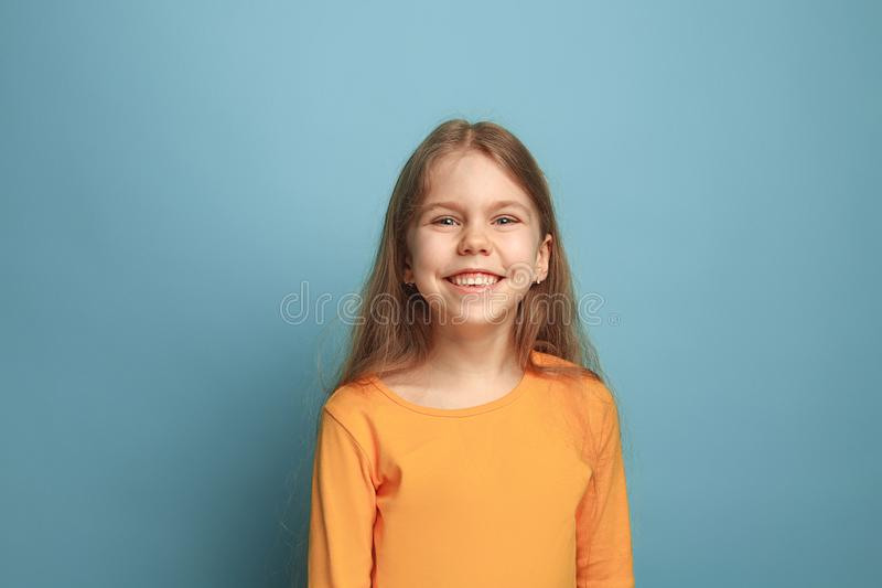 Win - emotional blonde teen girl have a happiness look and toothy smiling. Studio shot stock photo