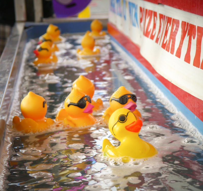 Win a prize everytime. Rubber duckies at a carnival or fair in a game pond where you can win a prize every time royalty free stock images