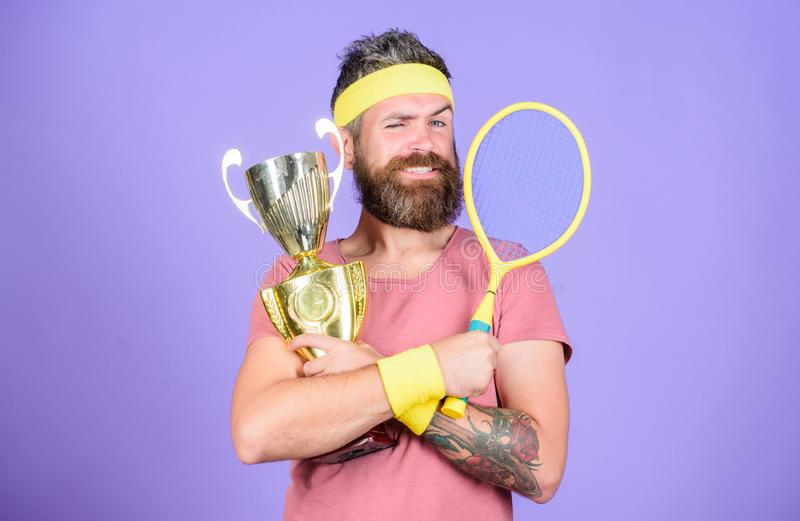 Win tennis game. Win every tennis match i take part in. Tennis player win championship. Athlete hold tennis racket and. Golden goblet. Man bearded hipster wear royalty free stock photo