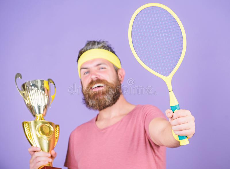 Win tennis game. Man bearded hipster wear sport outfit. Success and achievement. Win every tennis match i take part in. Tennis player win championship. Athlete royalty free stock photo