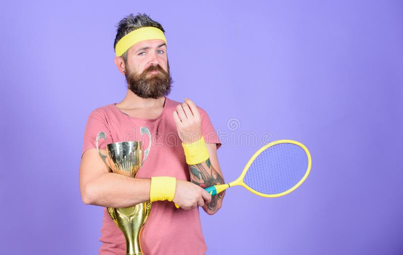 Win tennis game. Man bearded hipster wear sport outfit. Success and achievement. Tennis match winner. Achieved top. Tennis player win championship. Athlete stock photos