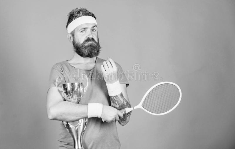 Win tennis game. Man bearded hipster wear sport outfit. Success and achievement. Tennis match winner. Achieved top. Tennis player win championship. Athlete royalty free stock photos