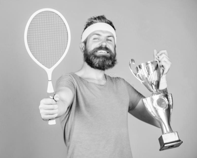 Win tennis game. No player can step on court against me and feel confident. Man bearded hipster wear sport outfit royalty free stock photography