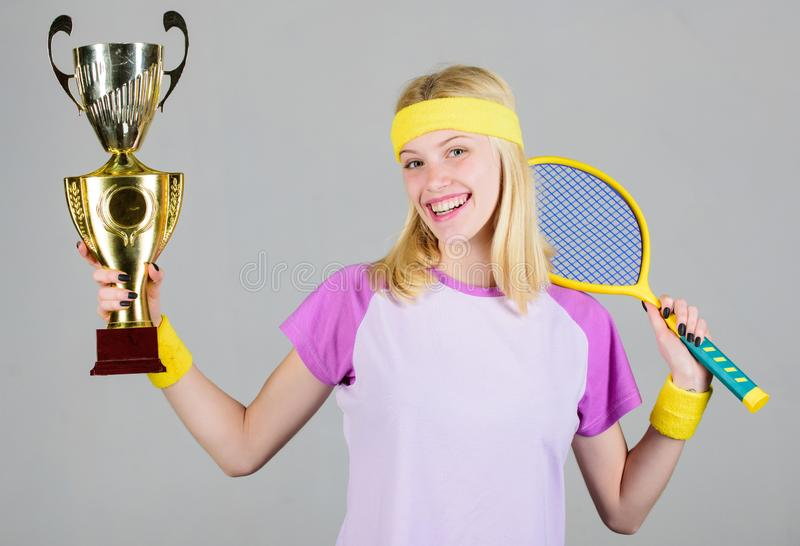 Win tennis game. Woman wear sport outfit. Tennis player win championship. First place. Sport achievement. Celebrate. Victory. Tennis champion. Athletic girl royalty free stock images