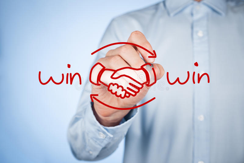 Win win strategy. Win-win partnership strategy concept. Businessman draw win-win scheme and handshake partnership agreement royalty free stock image