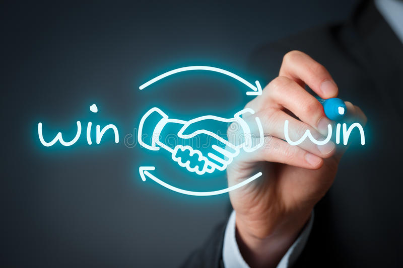 Win win strategy. Win-win partnership strategy concept. Businessman draw win-win scheme with handshake partnership agreement stock photo