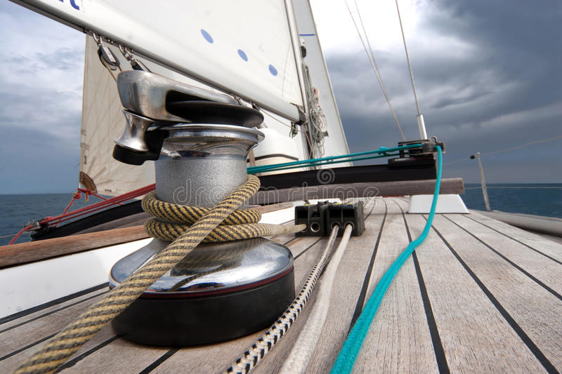 Winch with rope on sailing boat stock photography