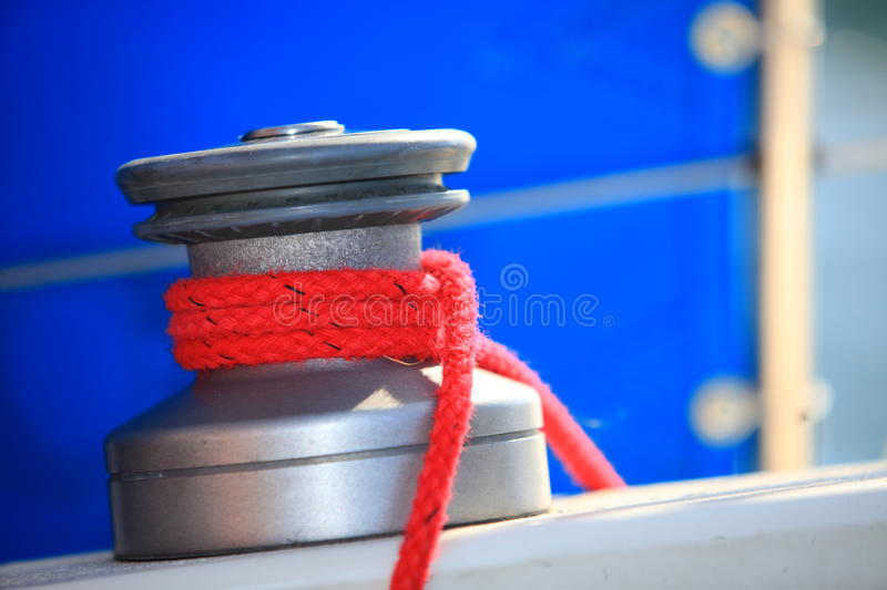 Winch with rope on sailing boat rigging royalty free stock images