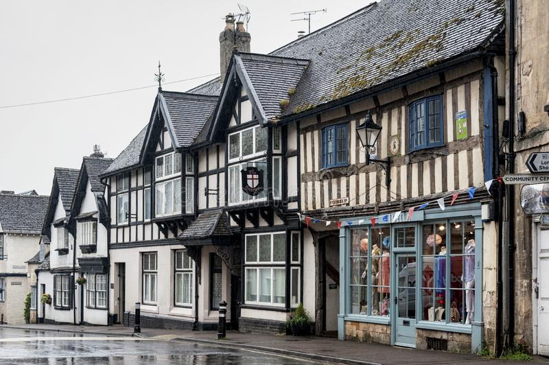 Medieval half timbered buildings in the main street of the ancient Anglo Saxon town of Winchcombe, Cotswolds, Gloucestershire. WINCHCOMBE, ENGLAND -MAY, 25 2018 stock photos
