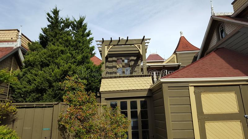 Winchester Mystery House. San Jose, California, United States - April 07, 2017: Victorian style roof with gables at the Winchester Mystery House, a popular royalty free stock photo