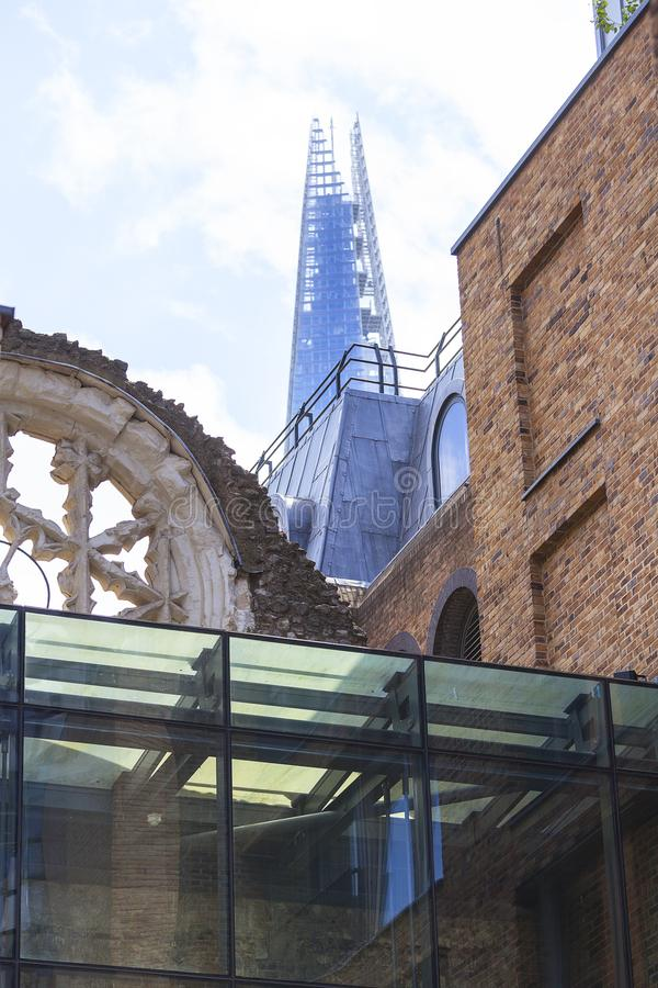 Winchester Palace, rose window, The Shard skyscraper in the background, London, United Kingdom.  royalty free stock photography