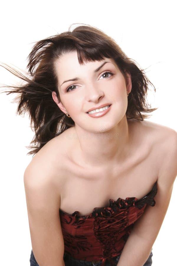 Wind. Beautiful young girl in studio royalty free stock photo