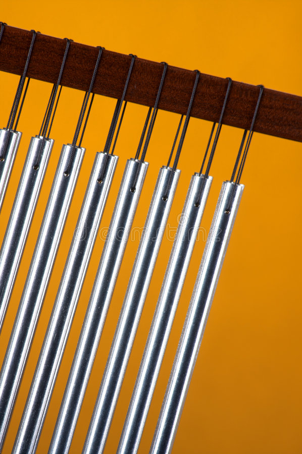 Download Wind or Bar Chimes on red stock photo. Image of noise - 7669022