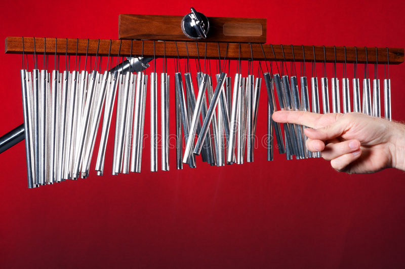Download Wind or Bar Chimes on red stock photo. Image of metal - 7669062